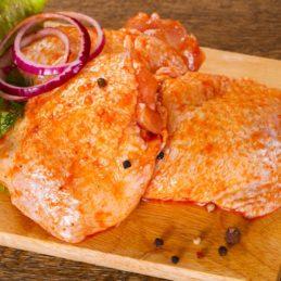 Raw marinated chicken thighs